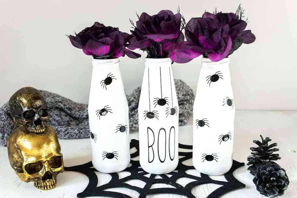 Single Girl's DIY created a beautiful Creepy Halloween Spider Vases by upcycling glass bottles and using cricut vinyl for the SVG cut files