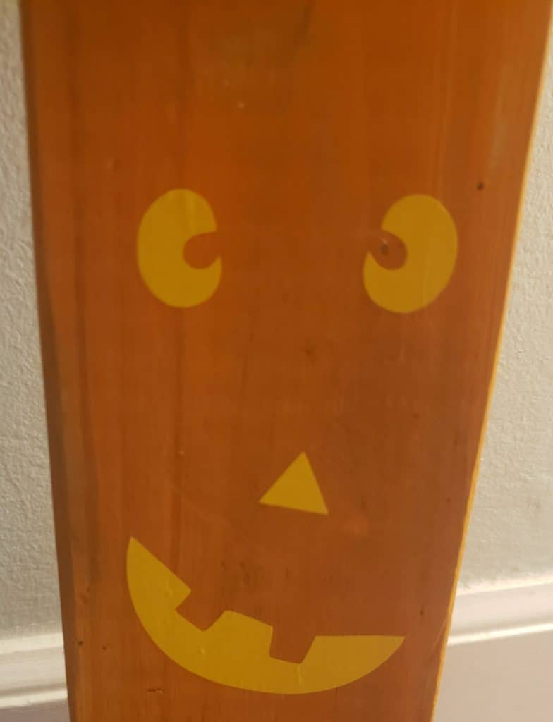 DIY Pumpkin Face on wood after we painted it