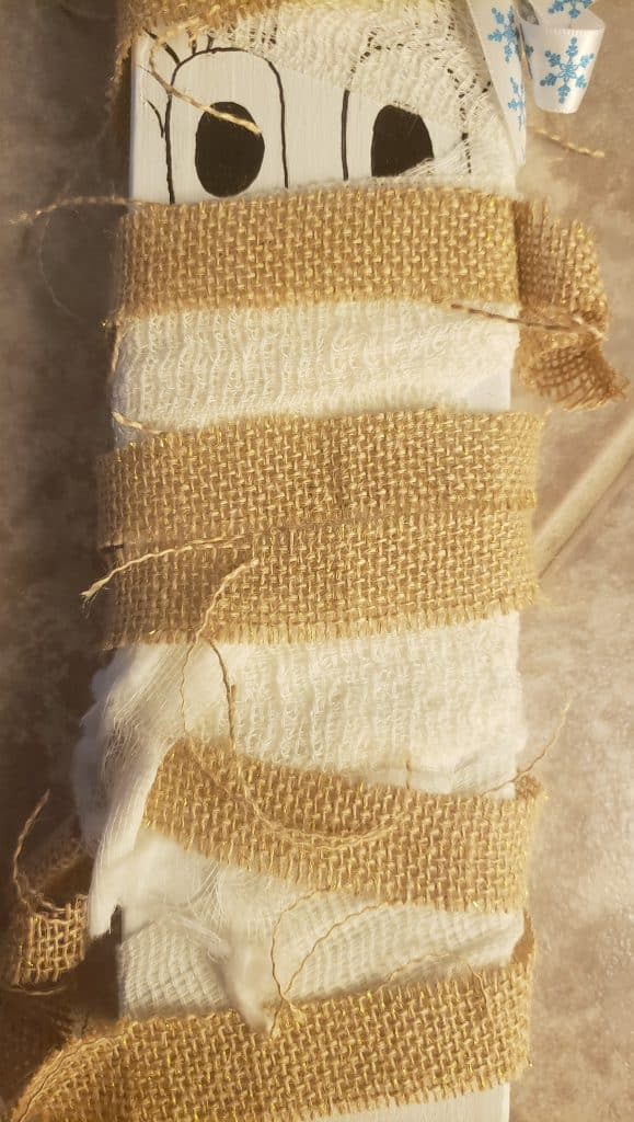 Halloween Family DIY Wood Project Tutorial- A Close up of the mummy so you can see how we placed the gauze and burlap on the mummy