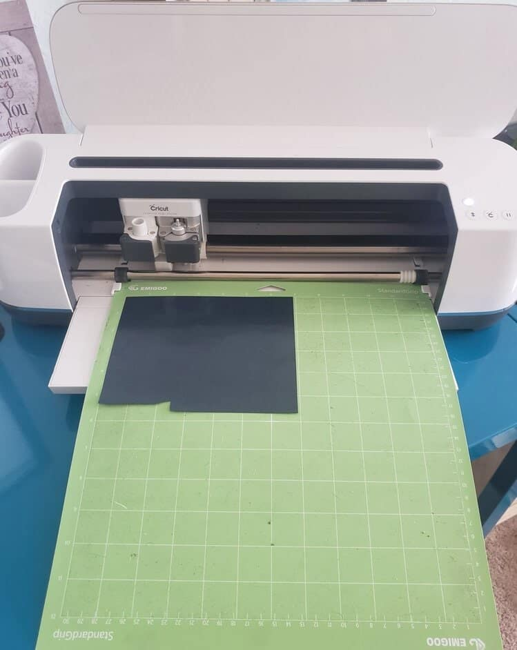 Lets make sure both our mats are mirrored again. Then We are now sending our black Iron-on into our cutting machine so that our Cricut can cut out the word lucky.