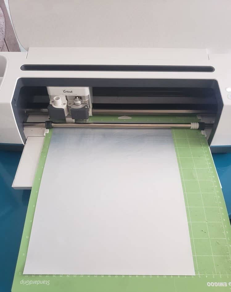 Now we are cutting the other mat, which is Foil HTV or whatever material you chose. We will now send this into our cutting machine once the material is changed so it can cut the Shamrock