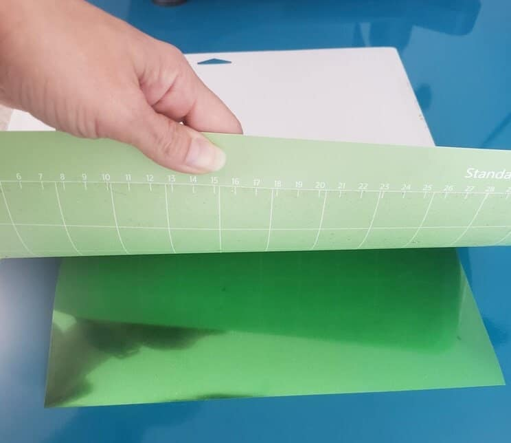 Lets peel our materials away from the cricut cutting mat like so.