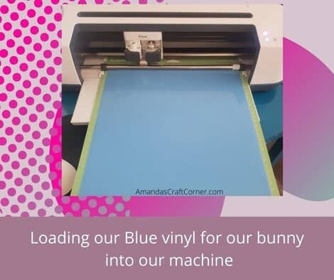 WE have already cut the white and black now now we are loading our Blue Vinyl into our cutting machine so it can cut the bunny.