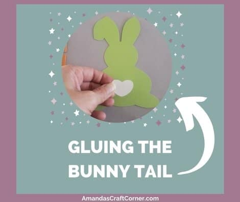 Putting our DIY Easter Banner together- gluing the bunny tail on the bunny
