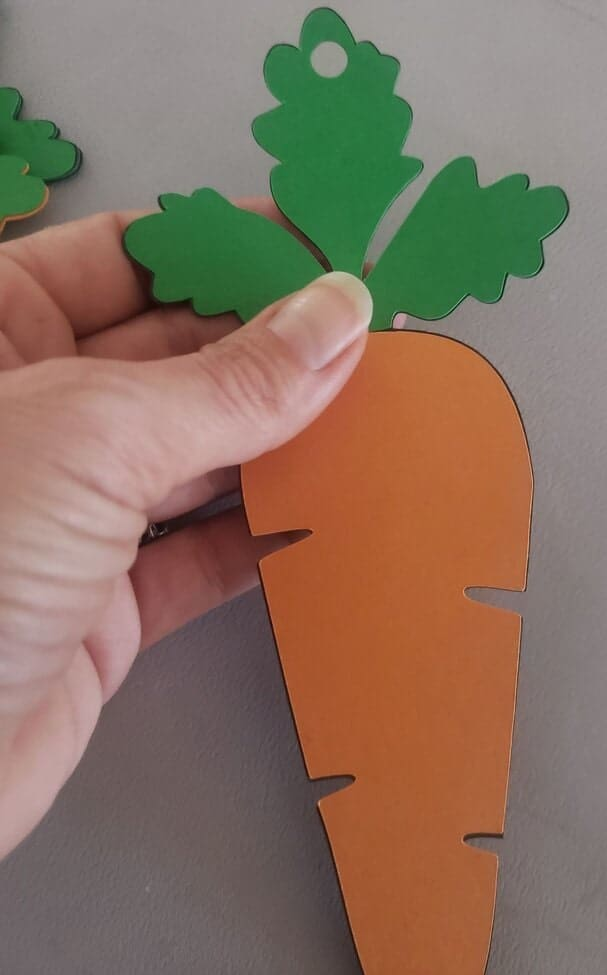 Hole punching the carrot for our DIY Easter Banner