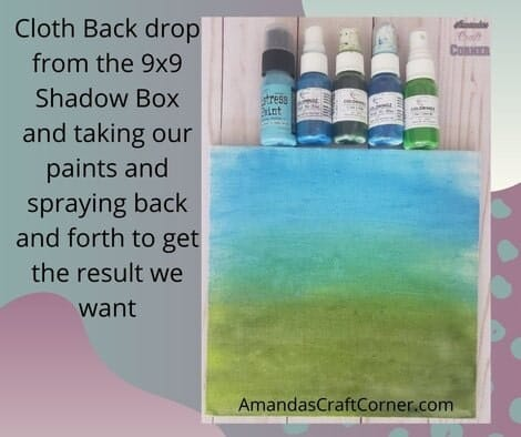 DIY Multi-media Shadow Box- Prepping and painting the cloth backdrop of our shadow box. Cloth Back drop from the 9x9 Shadow Box and taking our paints and spraying back and forth to get the result we want