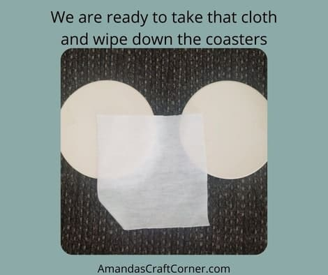 So let's open the blank package of coasters, grab that little towel that comes in the package, and start wiping off the blanks to make sure there are no dust particles on there.