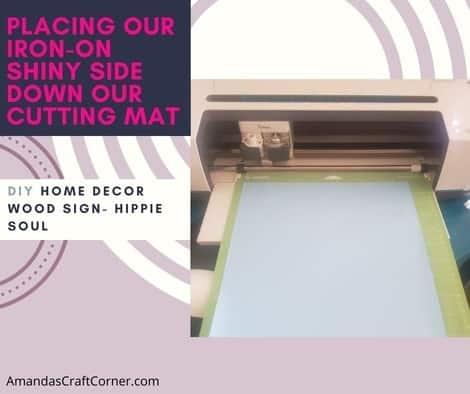 Placing our Iron-on on our cutting mat so our SVG can be cut for our DIY Wood Home Decor Sign